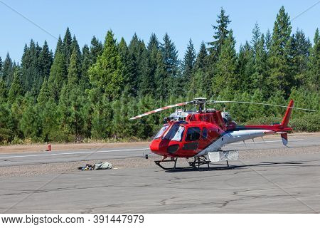 Prospect,  Oregon / Usa - September 9, 2014:  A Small Rescue Helicopter Is On Standby At The Prospec