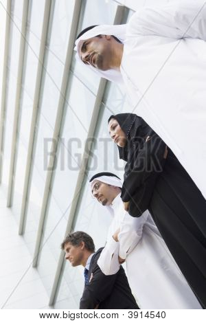 Middle Eastern And Western Business Men / Women Standing Outside Offices