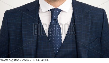 Tie Goes Inside Vest. Vested Three-piece Suit Worn With Tie. Necktie Collection. Fashion Accessory.