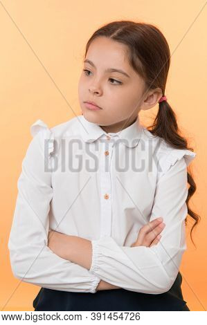 Not In Her Best Mood. Girl School Uniform Serious Face Offended Yellow Background. Kid Unhappy Looks