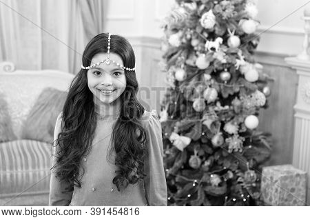 Making Holiday Bright. Happy Kid Celebrate Xmas And New Year. Small Girl With Festive Holiday Look.