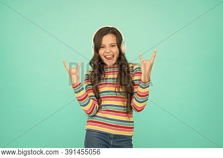 Good Track Improves Mood. Happy Small Girl Listen Music. Little Child Enjoy Song Playing In Headphon