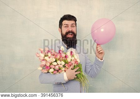 Add Holiday Cheer With This Festive Bouquet. Bearded Man Hold Tulips And Balloon. Holiday Celebratio