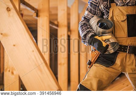 Hvac Technologies Theme. Air Ventilation Technician With Piece Of Metal Air Shaft In His Hands Stayi