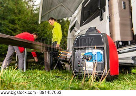 Modern Gasoline Powered Generator Running Next To Camper Van Recreational Vehicle. Powering Rv Campi