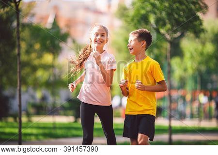Kids Run. Healthy Sport. Child Sport, Heterosexual Twins Running On Track, Fitness. Joint Training.
