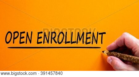 Hand Writing 'open Enrollment', Isolated On Beautiful Orange Background. Concept. Copy Space.