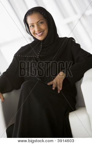 Middle Eastern Business Woman Sat On Chair