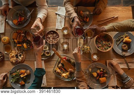 Above View Background Of Multi-ethnic Group Of People Enjoying Feast During Dinner Party With Friend