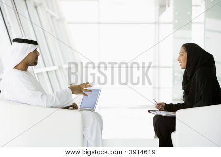 Middle Eastern Man / Woman Discussing Business
