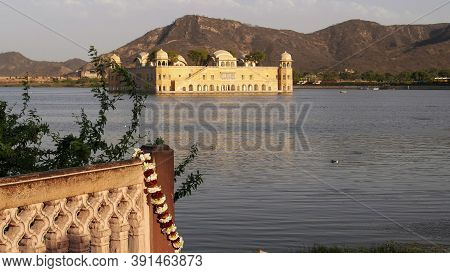 Garland On A Wall With Jal Mahal In The Background At Jaipur