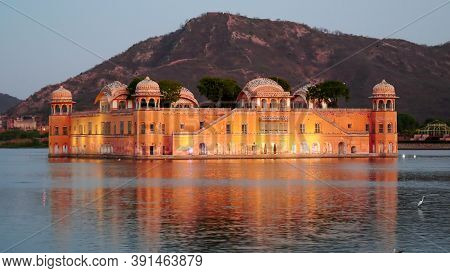 Evening Close Up Of Jal Mahal Palace Illuminated By Lights In Jaipur