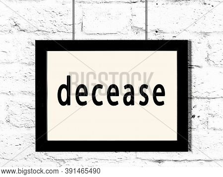 Black Wooden Frame With Inscription Decease Hanging On White Brick Wall