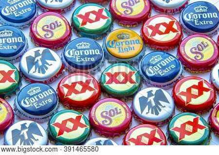 Calgary, Alberta, Canada. Oct 25, 2020. Popular Mexican Beer Caps On A Clear Background. Corona Extr