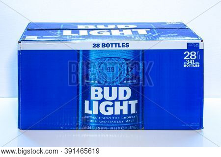 Calgary, Alberta, Canada. Oct 25, 2020. A 28 Box Of Beer Bottles Of Bud Light On A White Background.
