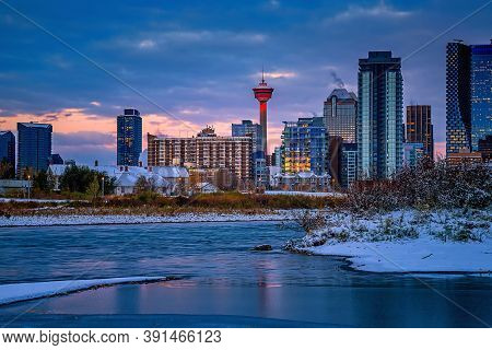 Cloudy Sky Over A Wintry Downtown Calgary From Across The Bow River