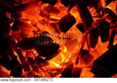 Coarse Anthracite Coal Flares Up From Wood As A Background.