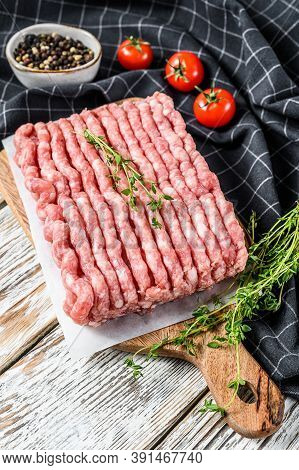 Raw Minced Pork On A Chopping Board. Organic Ground Meat, Forcemeat. White Background. Top View