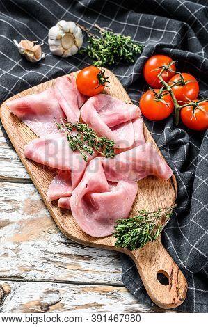 Sliced Ham. Fresh Prosciutto. Pork Ham Sliced. White Wooden Background. Top View