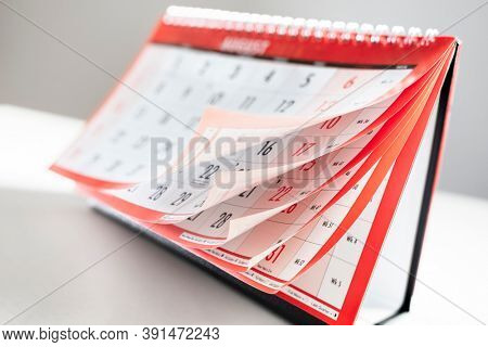 Calendar showing months and dates whilst turning the pages