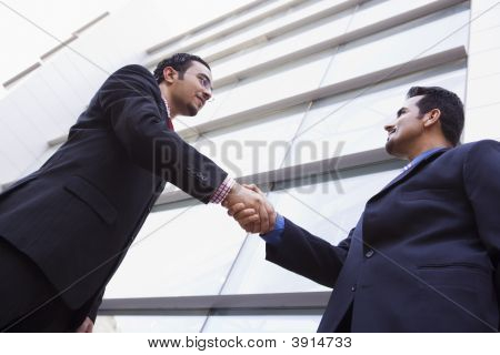 Middle Eastern Business People Shaking Hands