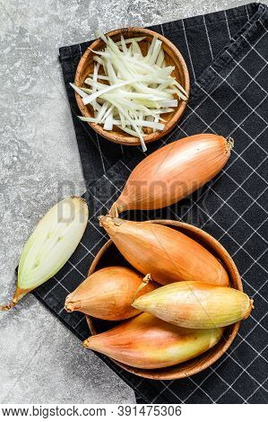 Yellow Raw Shallot Onions, Sliced And Halved. Gray Background. Top View