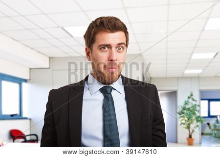 Portrait of a businessman with a funny facial expression