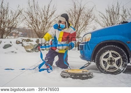 Man With Towing Rope Hooks Near Towed Car Wear Medical Masks Due To The Covid-19 Coronavirus