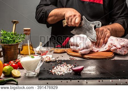 How To Prepare A Rabbit For Cooking. Hands Of A Chef Preparing A Rabbit Roast Displaying The Skinned