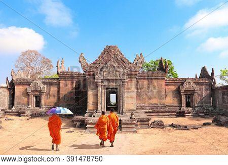 Three buddhist monks go to Gopura I in Preah Vihear Temple complex (Prasat Phra Wihan), Cambodia. UNESCO world heritage site