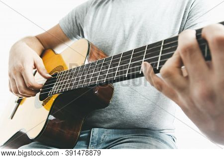 Close-up Of Guitarist Hand Playing On Classical Guitar