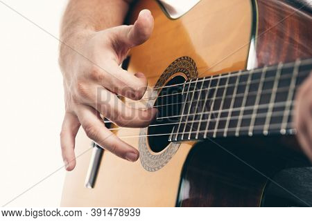 Close Up Of Mans Hands Playing Acoustic Guitar Flamenco, Taking Rasgueado. Music For Recreation Or H