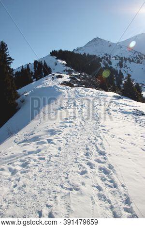Winter Trail On Furmanov Peak In Mountain Ridge Alatau, Almaty, Kazakhstan, Kimasar Gorge. Vertical.