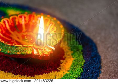 Close Up Clay Lit Light A Fire Already On Diya Or Oil Lamp On Concrete Background, Decoration Of Hin