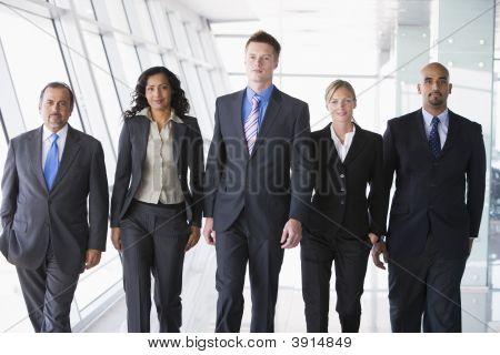 Middle Eastern / Western Business People Walking Down Corridor