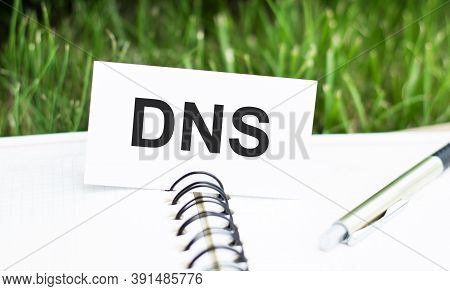 Dns- Domain Name System Written On The Card, Which Is On The Open Notebook