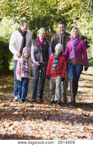 Generational Family Walking Through Woodland