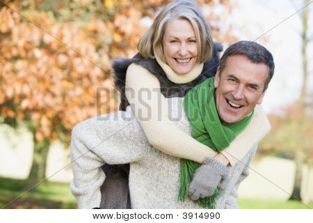 Man With Wife On Back In Woodland