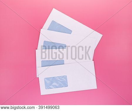 Blank Envelopes With Address Window Isolated On Pink Background. White Paper Envelopes Mockup For Bu