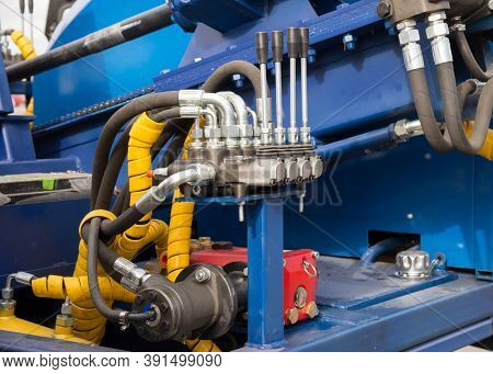 Hydraulic Tubes, Fittings And Levers On Control Panel, Close Up Of Pipe System Of Hydraulic Valves I