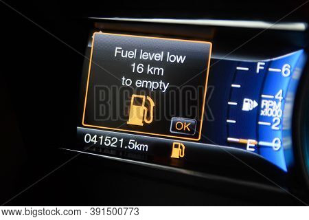 The On-board Computer Of A Modern Car With Color Infographics Warns The Driver About Insufficient Fu