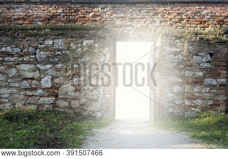Stoned Wall With A Open Door And White Glow
