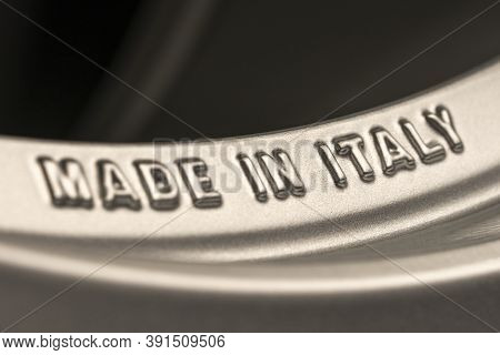 Made In Italy- Lettering On The Rim Of The New Alloy Wheel. Italian Industry And Production