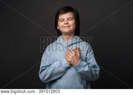 Thank You. Cheerful Boy 10-12 Years Old, Dressed In Casual Clothes, Smiles Gently And Presses Palms