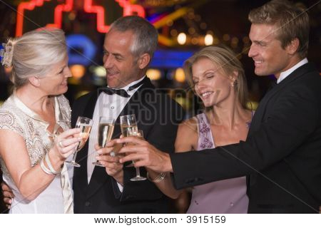 Couples In Casino With Champagne
