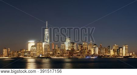New York City skyline with skyscrapers over Hudson River viewed from New Jersey at night