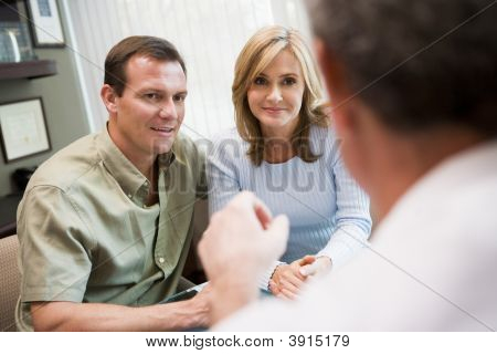 Couple in consultation at IVF clinic (selective focus) poster