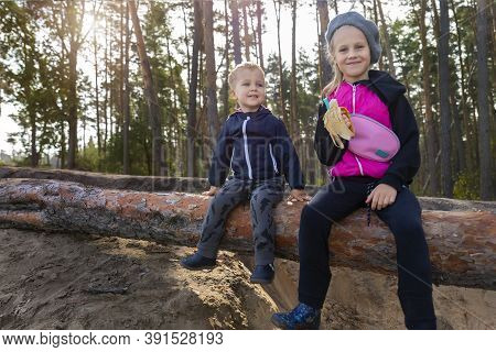 Portrait Of Two Cute Adorable Cheerful Playful Caucasian Sibling Children, Boy And Girl, Having Fun