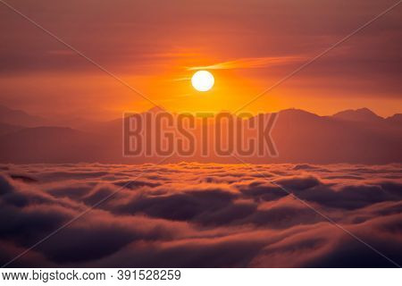 View of orange sunrise, valley fog and the San Gabriel Mountains