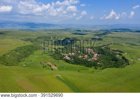 Flying Over A Village In Transylvania. Aerial Drone View Of Bica, Romania By Drone